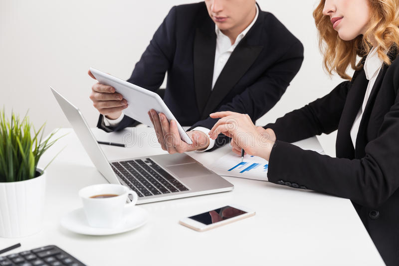 Close up of woman and man with gadgets stock image