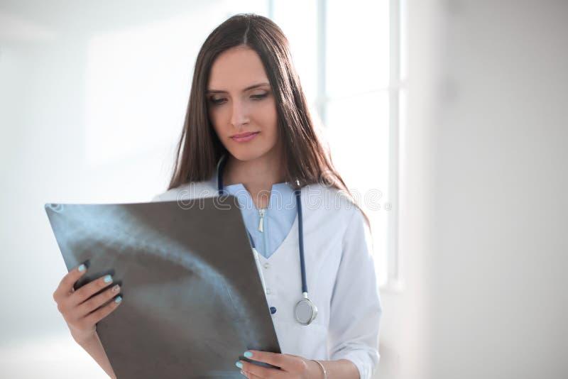Close up. woman medical doctor looking at x-ray royalty free stock photos