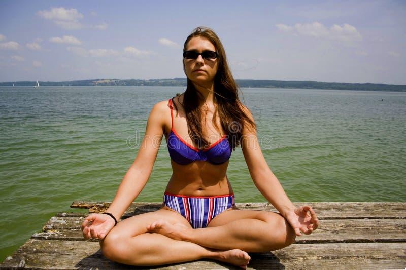Close up of woman meditating stock photography