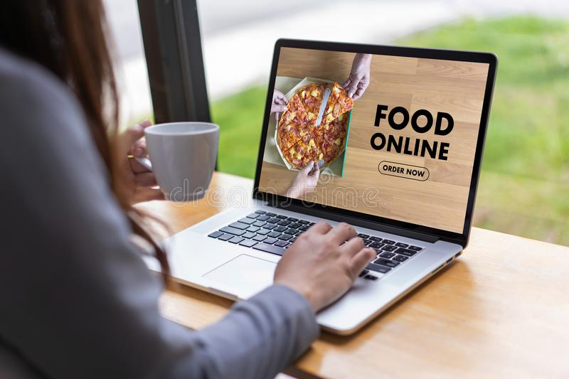 Close up woman ordering food online by internet Concept order. Food royalty free stock image