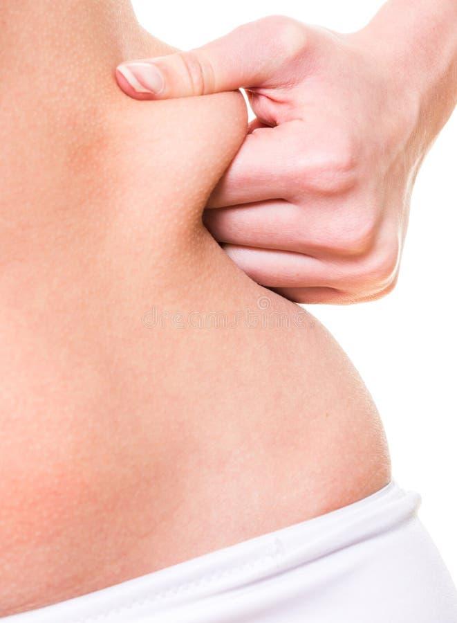 Close up woman pinching skin of her hip. Close-up of female pinching skin of her hip royalty free stock photos