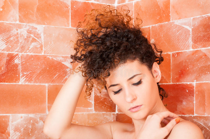 Close-up of woman portrait resting and enjoying in sauna room stock photography