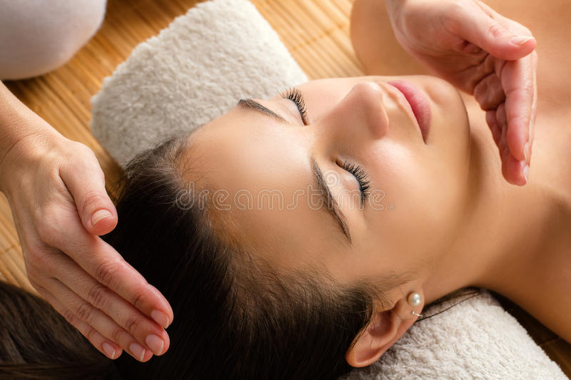 Close up of woman at reiki session. stock image