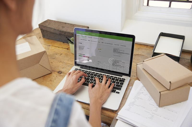 Close Up Of Woman Running Business From Home Dispatching Goods royalty free stock photo