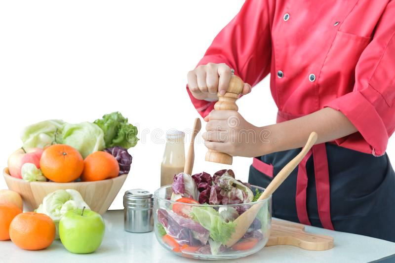 Woman`s chef hands cooking vegetables salad in the royalty free stock photography