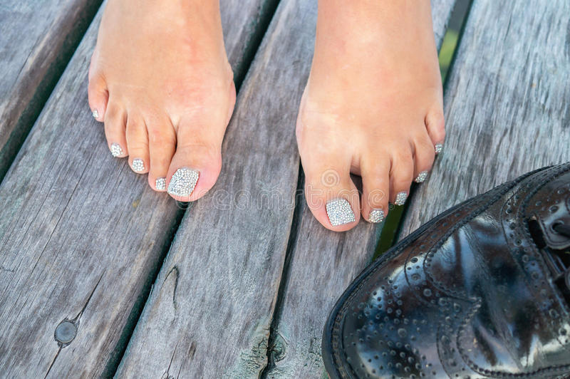 Close Up Of Woman`s Feet With Painted Fingernails And Black Men ...