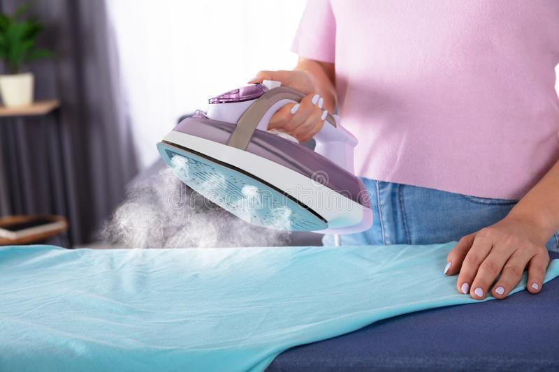 Close-up Of A Woman Ironing Cloth royalty free stock photography