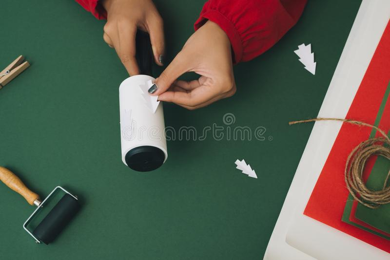 Close up of woman`s hands doing handcrafts for Christmas decoration. Xmas concept stock photo