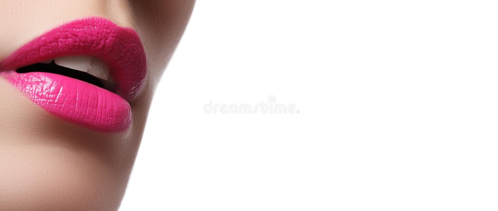 Close-up of woman`s lips with bright fashion pink glossy makeup royalty free stock photos
