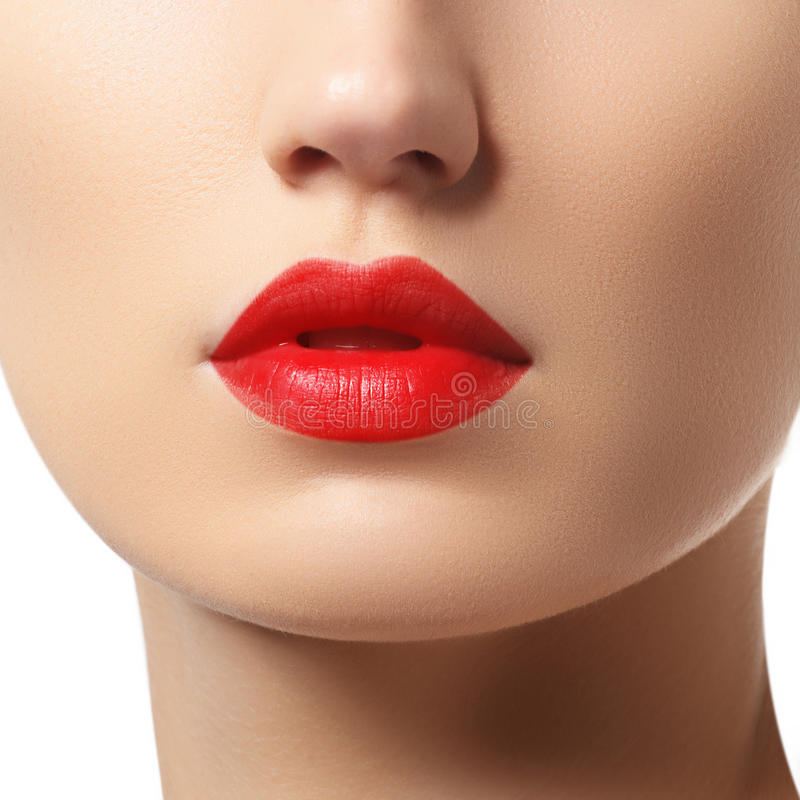 Close-up of woman`s lips with bright fashion red glossy makeup. Macro bloody lipgloss make-up stock images