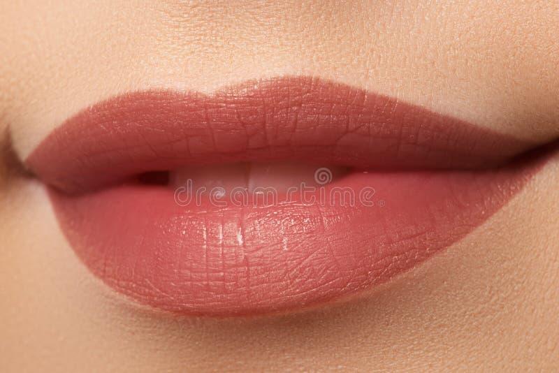 Close-up of woman`s lips with fashion natural white coffee lips. Tick makeup. Horizontal macro pale lipgloss make-up royalty free stock photo