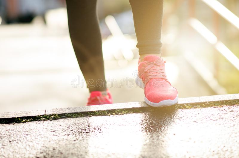 Close up of woman´s sports shoes. Young woman running up stairs. Healthy lifestyle. Fitness sport. Cardio training royalty free stock photo