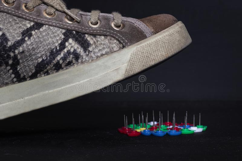 close up of a woman shoe that is about to step on some needles royalty free stock image