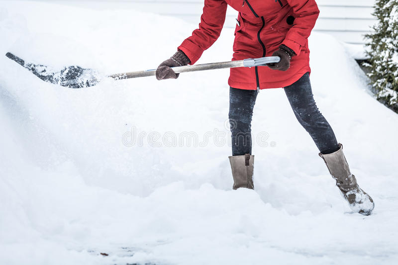 Close-up of Woman Shoveling her Parking lot. After Snowstorm royalty free stock photos