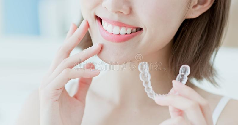Woman take invisible braces stock photos