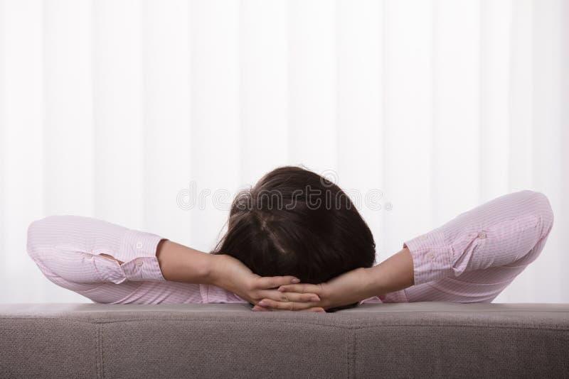 Close-up Of A Woman On Sofa stock photos