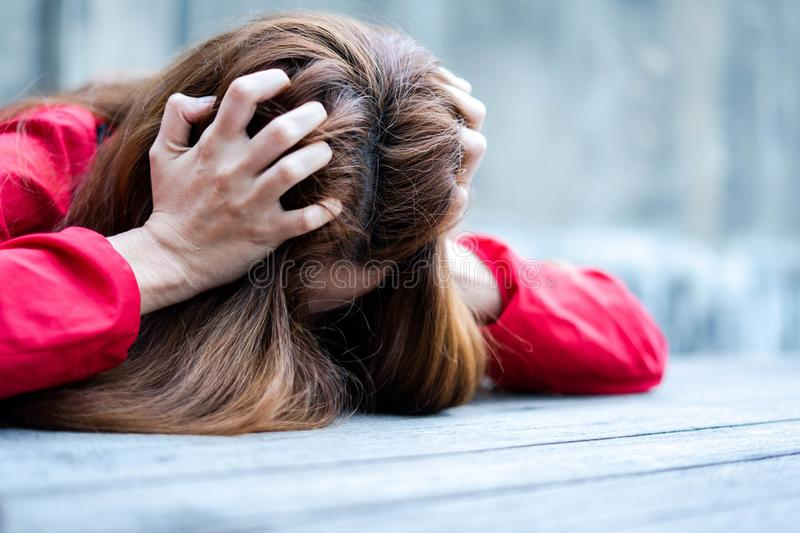 Close up Woman stressed is going crazy pulling her hair in frustration. Angry and stressed woman stock photography