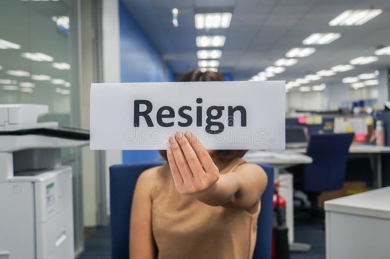 Woman submit a resignation letter in office at the end of the year. Close up woman submit a resignation letter in office at the end of the year stock photos