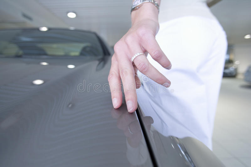 Close up of woman touching new car stock images