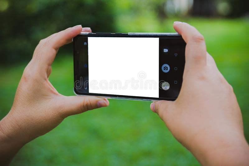 Close up of a woman using mobile smart phone outdoor.  stock images
