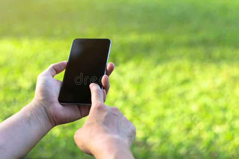 Close up of a woman using mobile smart phone with touch screen d woman using mobile smart phone with touch screen display stock photos