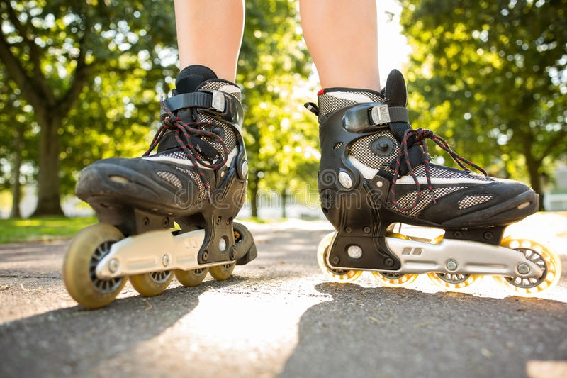 Close up of woman wearing inline skates royalty free stock photos