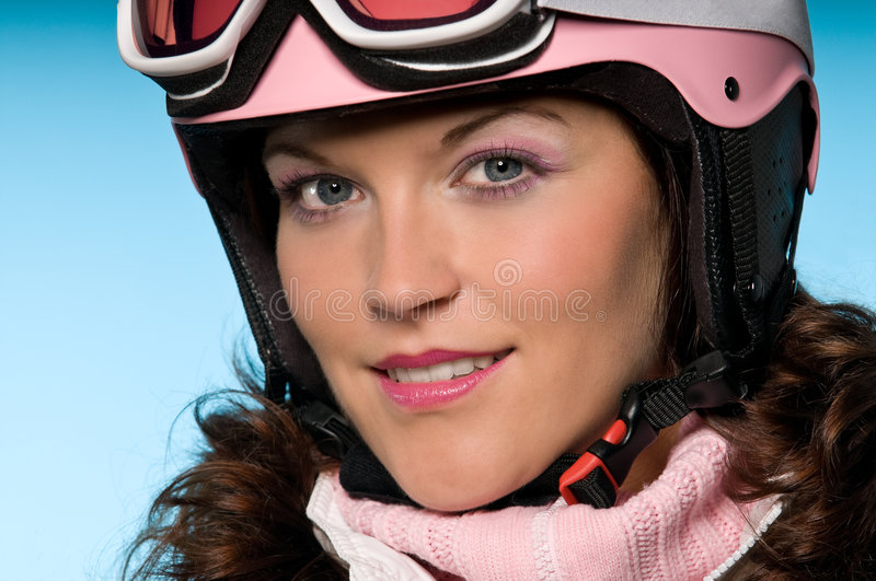 Close-up of woman wearing pink helmet