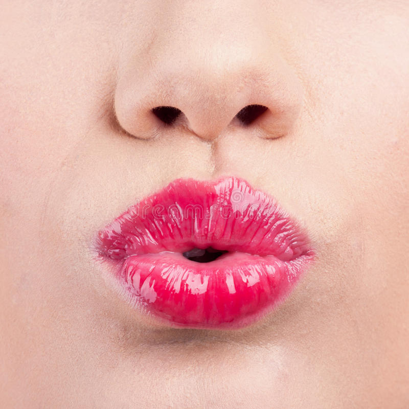 Close up of womans pouting lips with lipstick stock image