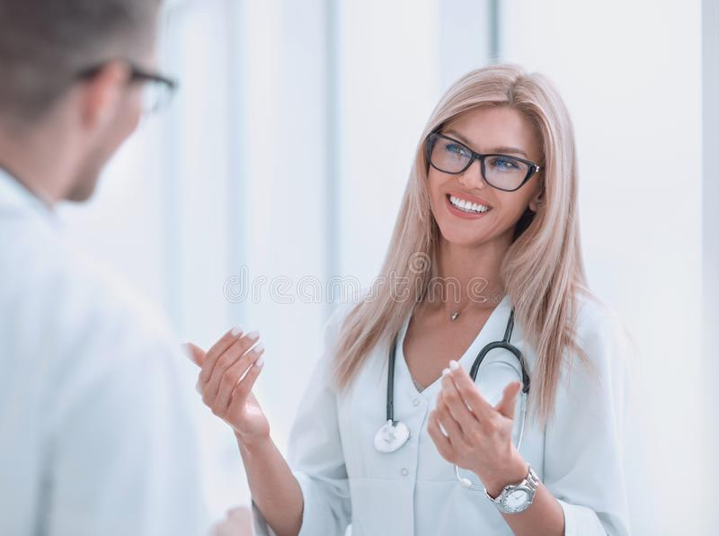 Close up. woman doctor talking to colleague stock photo