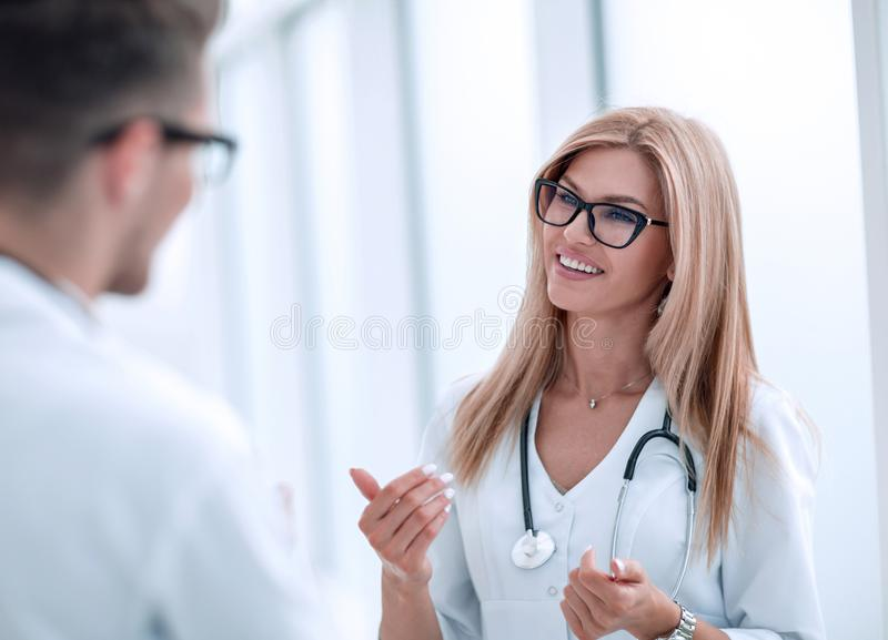 Close up. woman doctor talking to colleague stock image