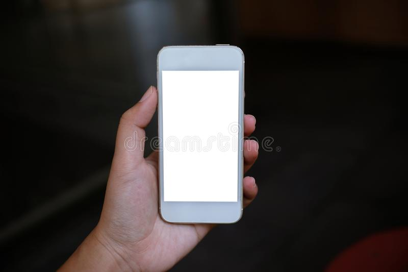 Close up of women& x27;s hands holding cell telephone blank copy spac royalty free stock photo