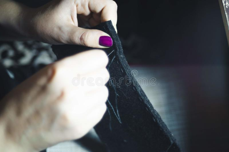 Hands of seamstress at work stock images