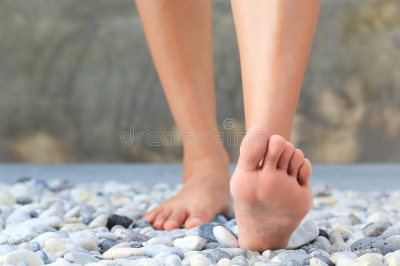 Close up of women walk on a rock, Relaxation and massage, Healthcare and spa stones concept.  royalty free stock image