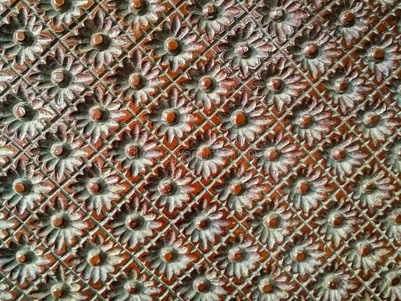 Close up of wood carved flower form pattern. stock image