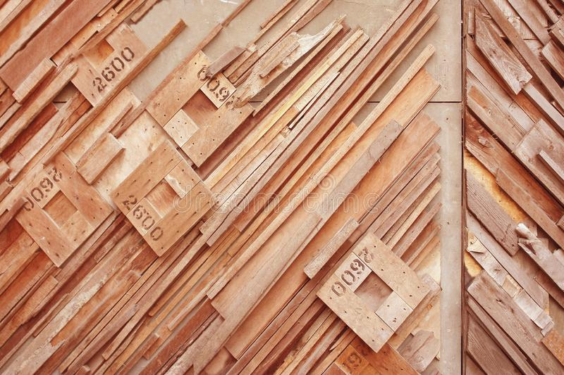 Wood rhombus shaped with number on oblique wood wall background stock photo