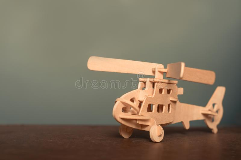 Close up wood toy helicopter on wood table. With copy space to fill royalty free stock image