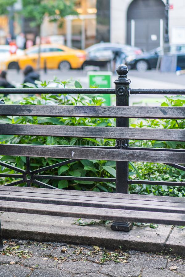 A close up of a wooden bench in the park. stock photography