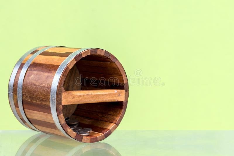Close up of wooden bucket with coins. Close-up of small wooden buckets Ancient patterns with coins falling on glass floor with green concrete walls as stock photos