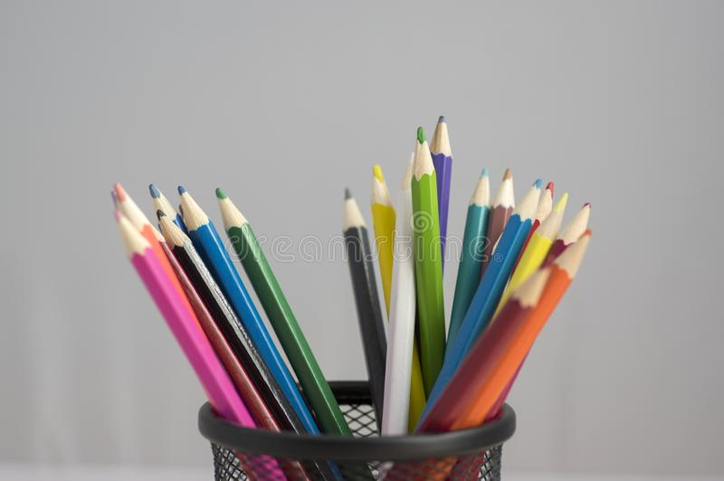 Close up of wooden colorful pencils, group of scattered crayons, isolate od white background stock photo