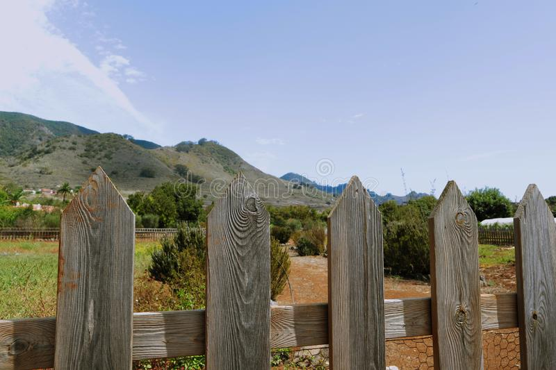 Close-up of a wooden fence in the countryside royalty free stock images