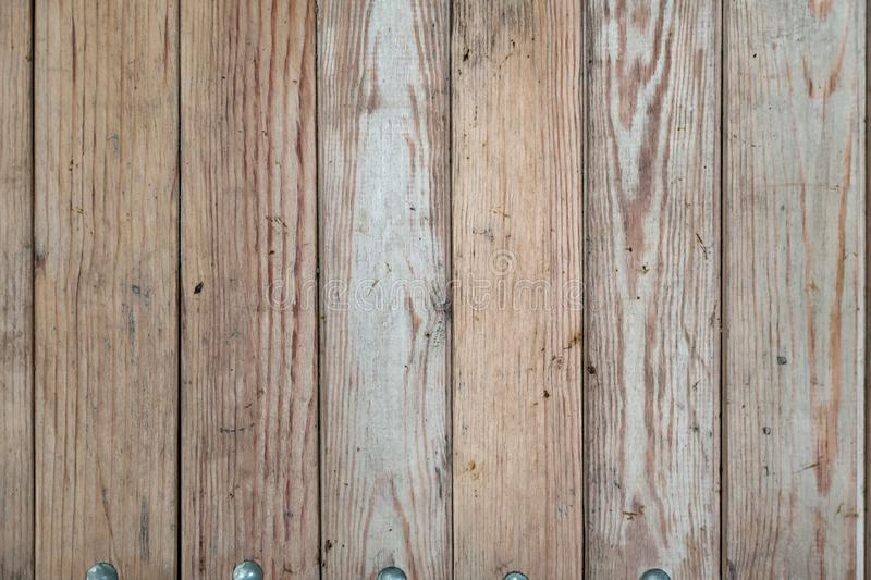 Close-up on a wooden flat surface with cracks on vertical boards with stripes and rings for the construction and manufacture of. Walls. Industry and natural stock photography