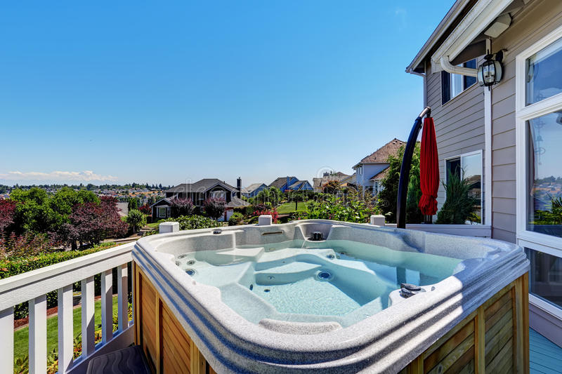 Close-up of wooden hot tub. Luxury house exterior. royalty free stock photos