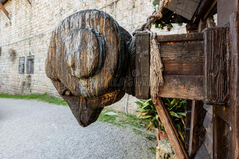 Close-up of a wooden medieval battering ram. Close-up of a medieval replica of a wooden battering ram, used to break open the walls of fortifications or the royalty free stock photos