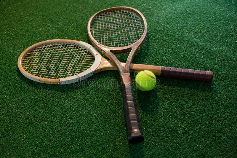 Close up of wooden rackets with tennis ball stock photography