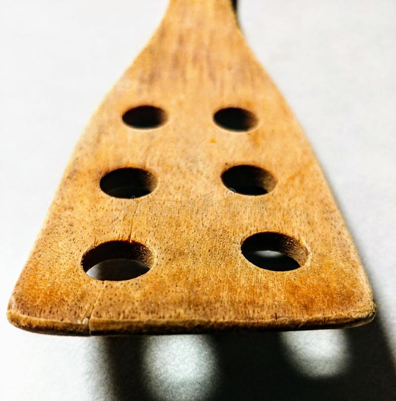 Wooden spatula with holes royalty free stock photo