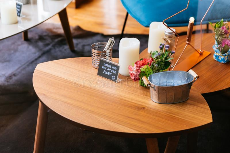 Close up Wooden table with words `Order and Pay at Bar Please` in french dessert cafe.  stock photo