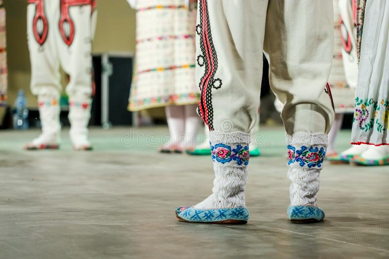 Close up of wool socks on legs of young Romanian dancer in traditional folkloric costume. Folklore of Romania royalty free stock photography