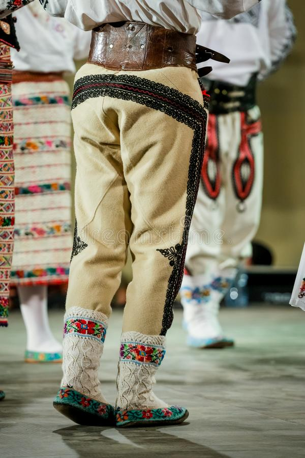 Close up of wool socks on legs of young Romanian dancer in traditional folkloric costume. Folklore of Romania royalty free stock image