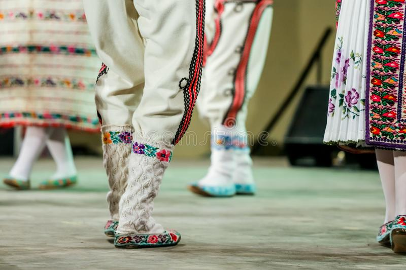 Close up of wool socks on legs of young Romanian dancer in traditional folkloric costume. Folklore of Romania royalty free stock photos