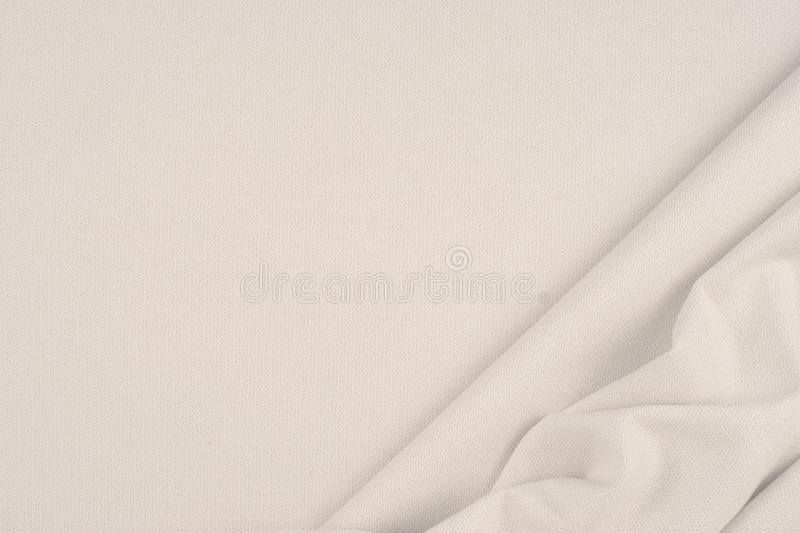 close up of a woolen fabric of beige color. Abstract background, empty template. Top view. royalty free stock photo